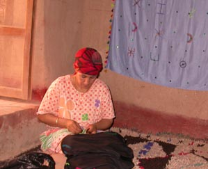 Embroider shawls in Ksar El Khorbat, south Morocco.